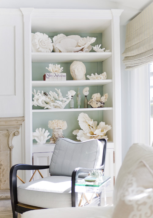 "Coastal Style - Keep pairings small with accents. A simple display case of ""found"" beach objects or a accent wall with driftwood keeps the airy feeling without being overwhelmed."