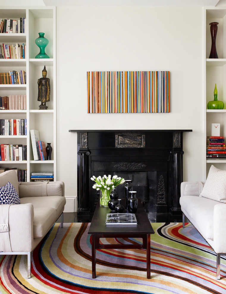 Inspiration for a contemporary living room library remodel in Boston with a standard fireplace and no tv