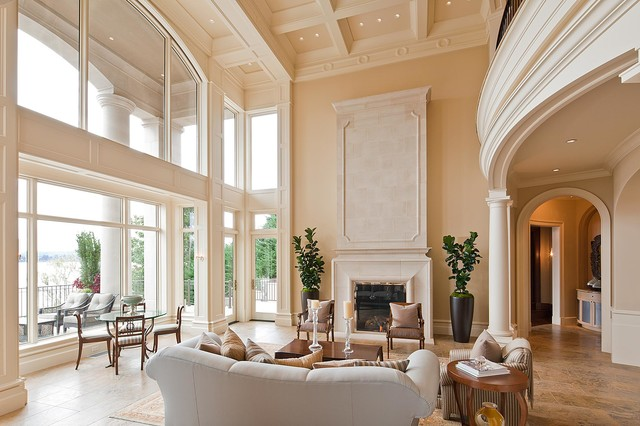 Example of a tuscan living room design in Seattle with beige walls and a  standard fireplace