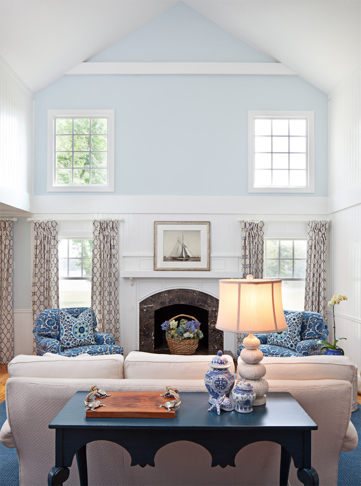 Inspiration for a timeless living room remodel in Baltimore with blue walls, a standard fireplace and no tv