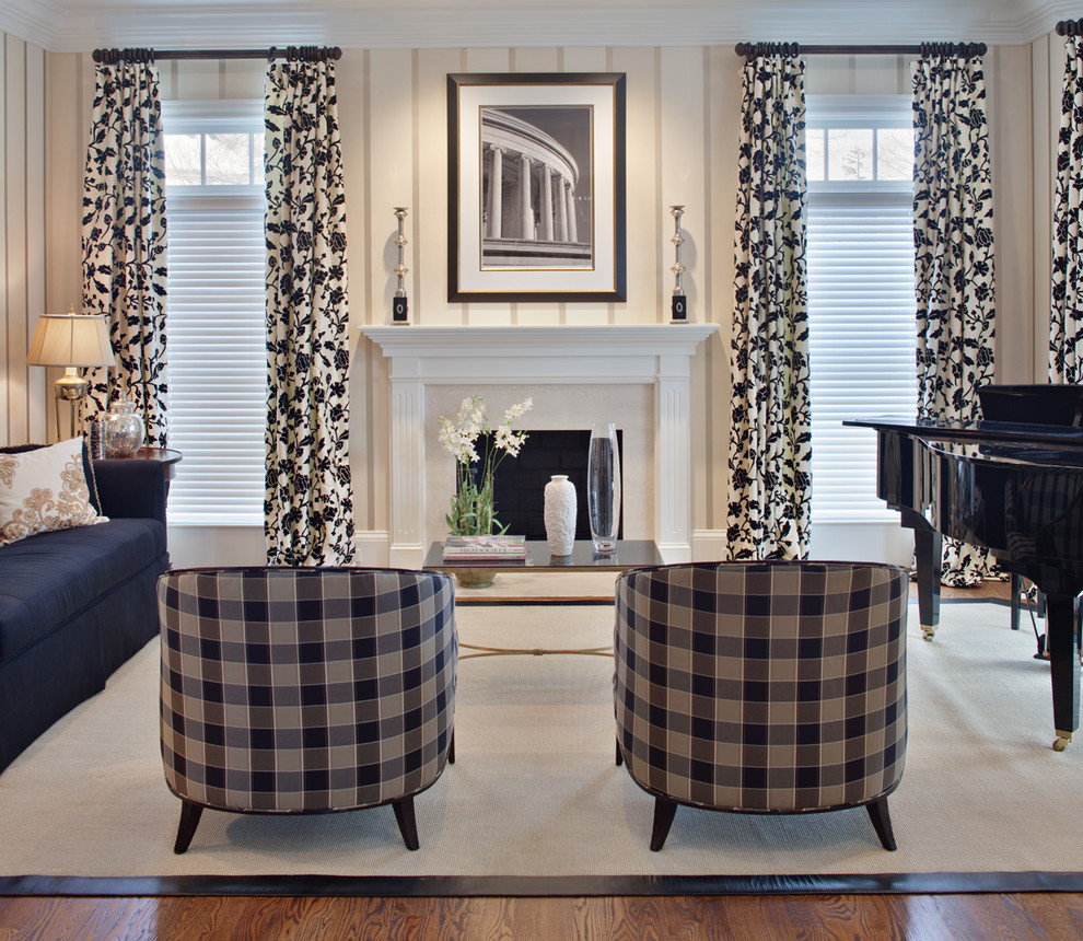 Living room - contemporary living room idea in Baltimore with a music area, beige walls and a standard fireplace