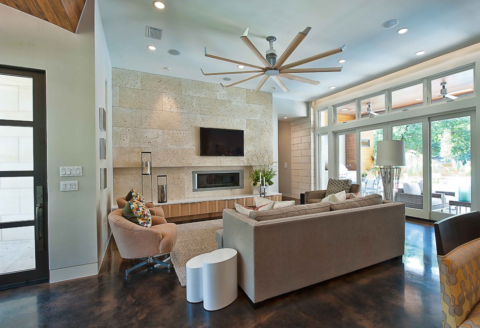 Trendy concrete floor living room photo in Austin