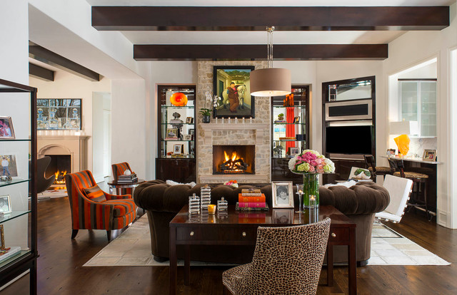 Inspiration for a transitional dark wood floor living room remodel in Dallas with white walls, a standard fireplace and a stone fireplace