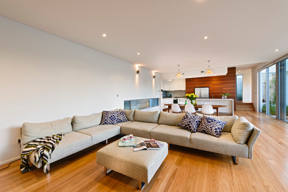 Example of a minimalist living room design in Perth with white walls