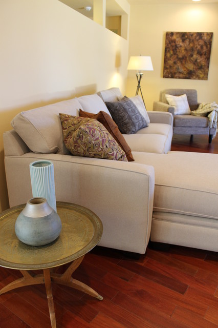 Brass tray table and neutral sectional sofa with pillows contemporary living room los - Types of tables for living room and brief buying guide ...