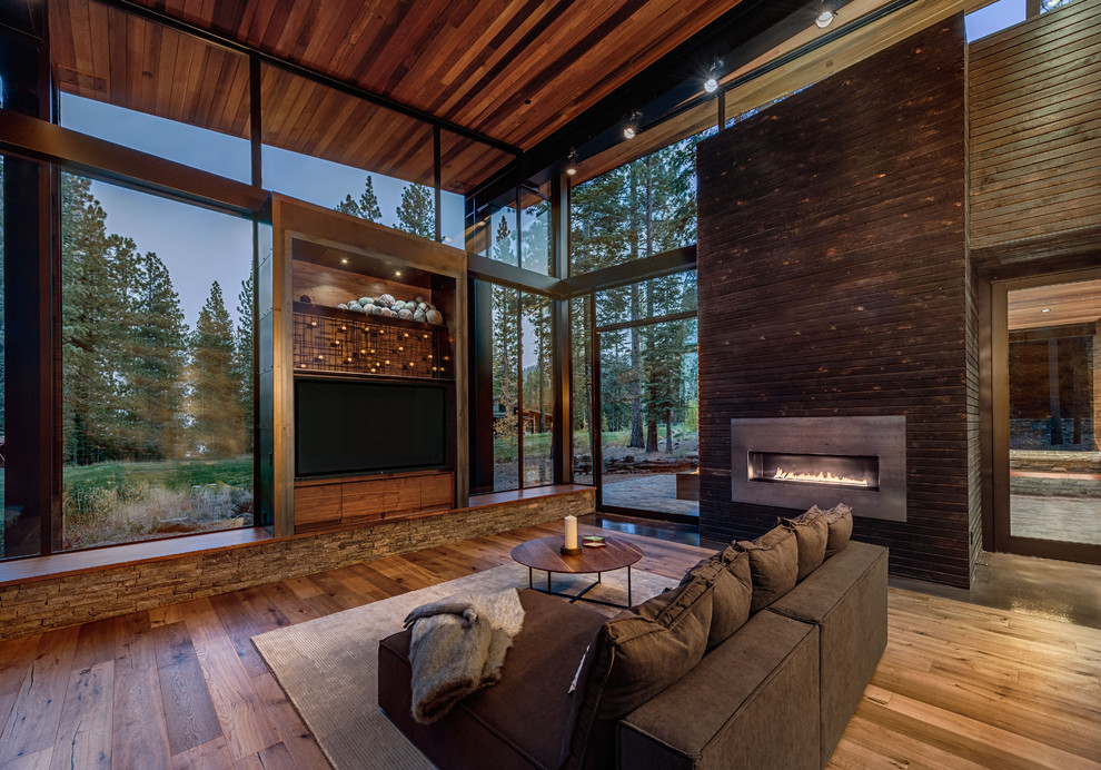 Example of a trendy dark wood floor living room design in San Francisco with a ribbon fireplace, a metal fireplace and a wall-mounted tv
