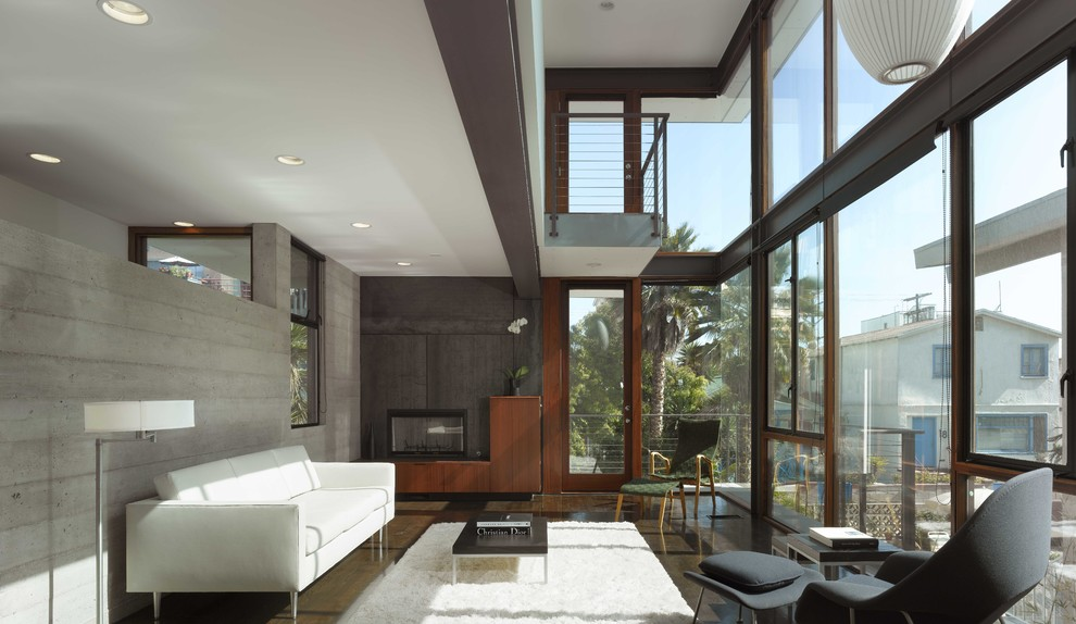 Inspiration for a modern living room remodel in Los Angeles with gray walls and a standard fireplace