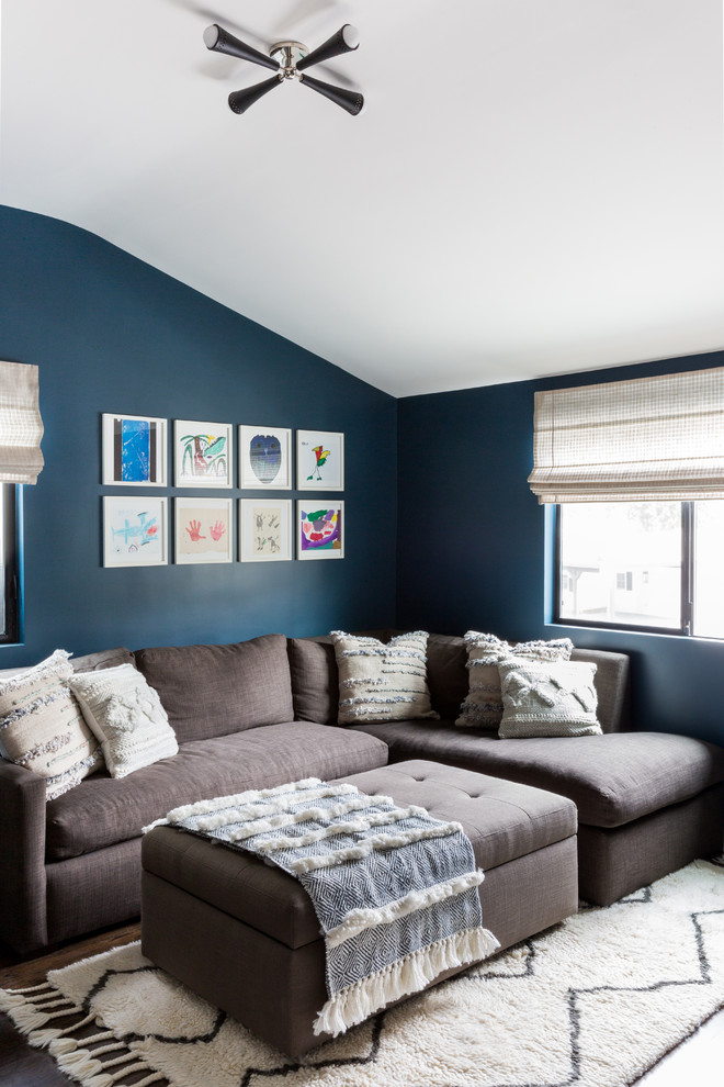 Inspiration for a small contemporary open concept dark wood floor and brown floor living room remodel in Los Angeles with blue walls