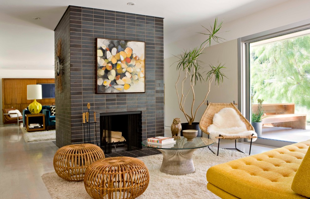 Inspiration for a 1960s open concept living room remodel in Los Angeles with white walls, a standard fireplace and a tile fireplace