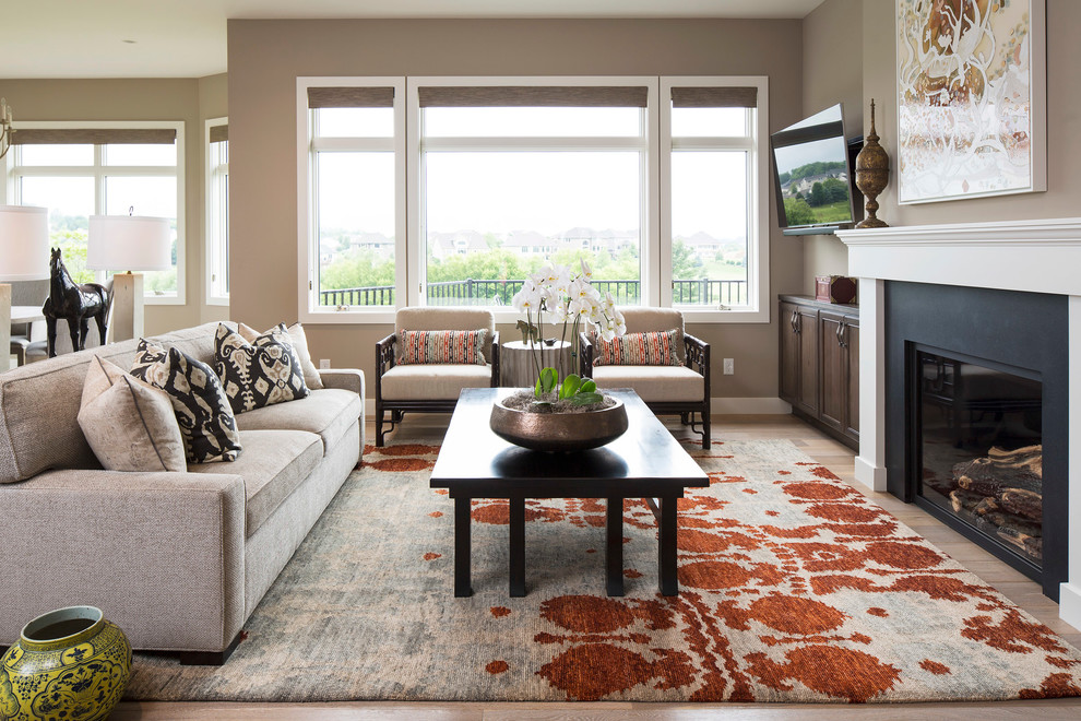 Living room - traditional formal medium tone wood floor living room idea in Minneapolis with brown walls, a standard fireplace and a wall-mounted tv