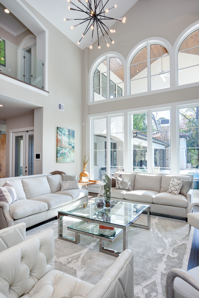 Inspiration for a large contemporary formal and open concept dark wood floor living room remodel in Houston with gray walls, no tv and no fireplace