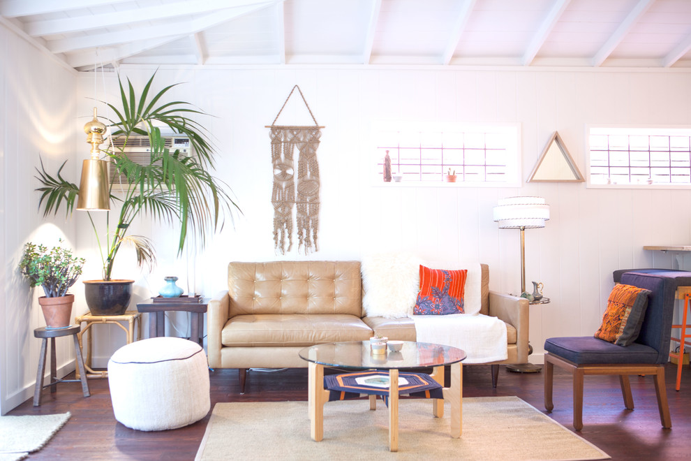 Mid-sized mid-century modern open concept medium tone wood floor and brown floor living room photo in Los Angeles with white walls and no fireplace