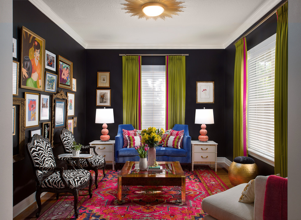 Example of an eclectic enclosed medium tone wood floor and brown floor living room design in Tampa with black walls