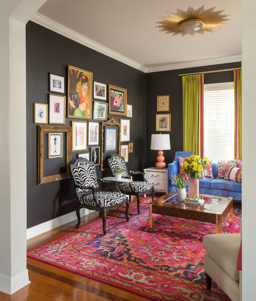 Inspiration for an eclectic light wood floor living room remodel in Tampa with black walls