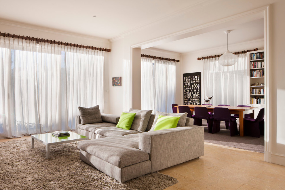 Example of a large trendy open concept travertine floor living room design in Melbourne with white walls