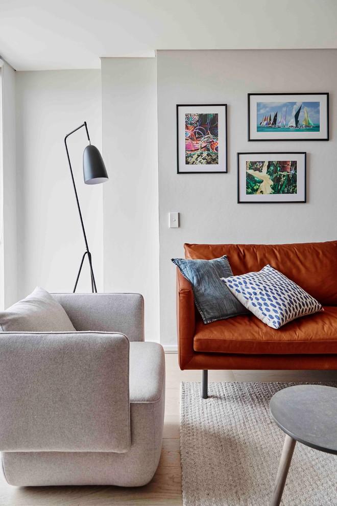 Small trendy open concept light wood floor and beige floor living room photo in Sydney with gray walls
