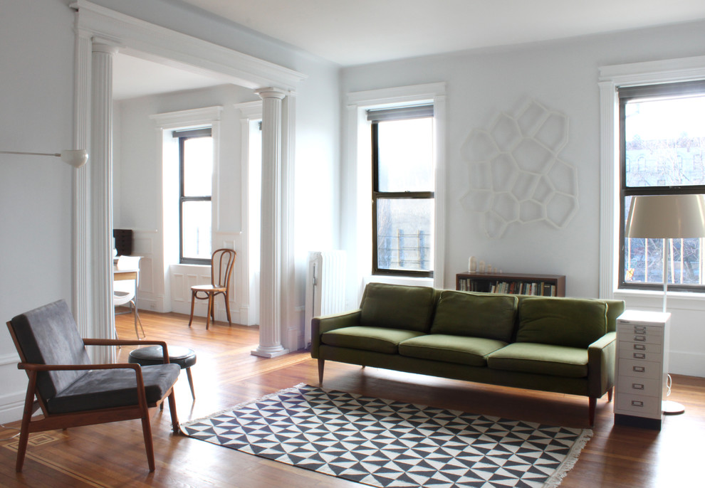 Living room - modern living room idea in New York with white walls