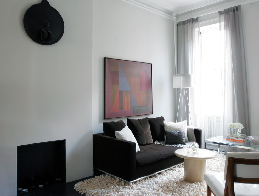 Living room - small modern formal and open concept painted wood floor living room idea in New York with gray walls, a standard fireplace, a wood fireplace surround and no tv