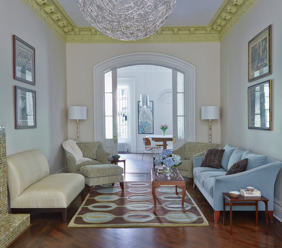 Transitional formal and enclosed dark wood floor living room photo in New York with beige walls and no tv