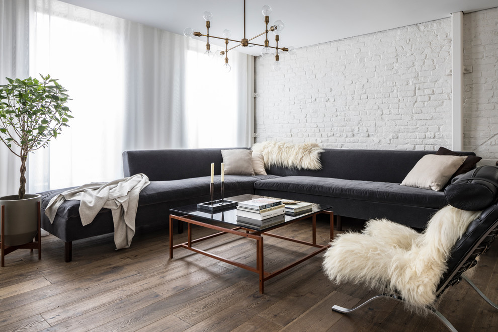 Inspiration for a mid-sized scandinavian open concept dark wood floor and brown floor living room library remodel in New York with white walls