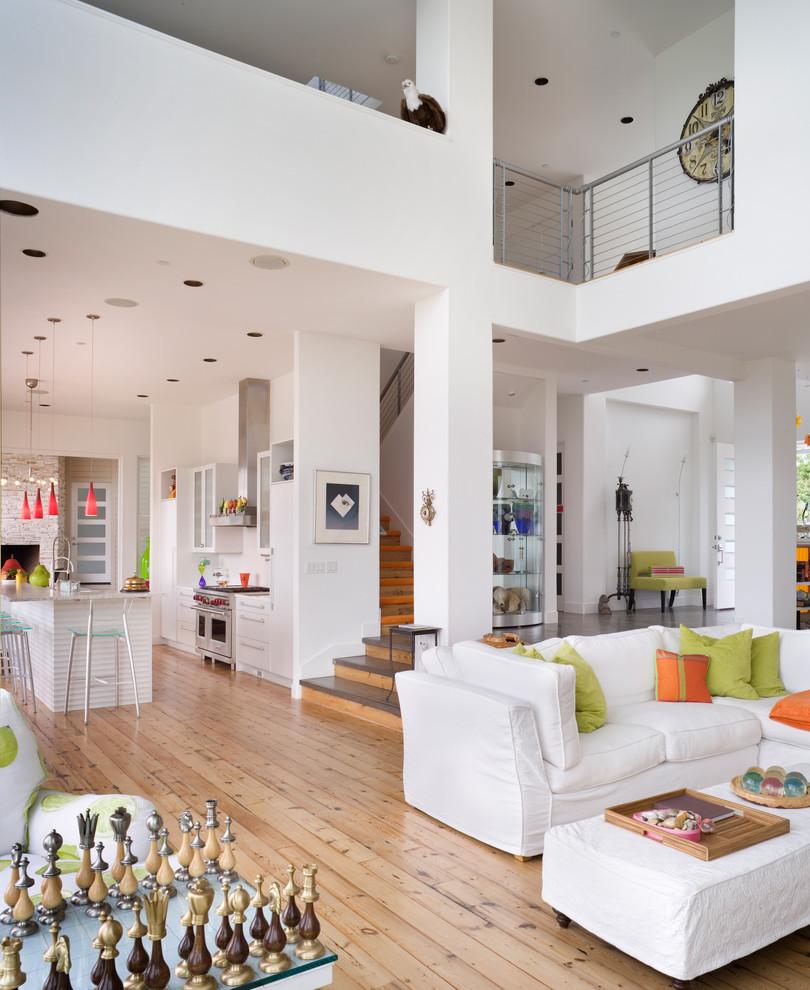 Trendy open concept beige floor living room photo in Portland with white walls