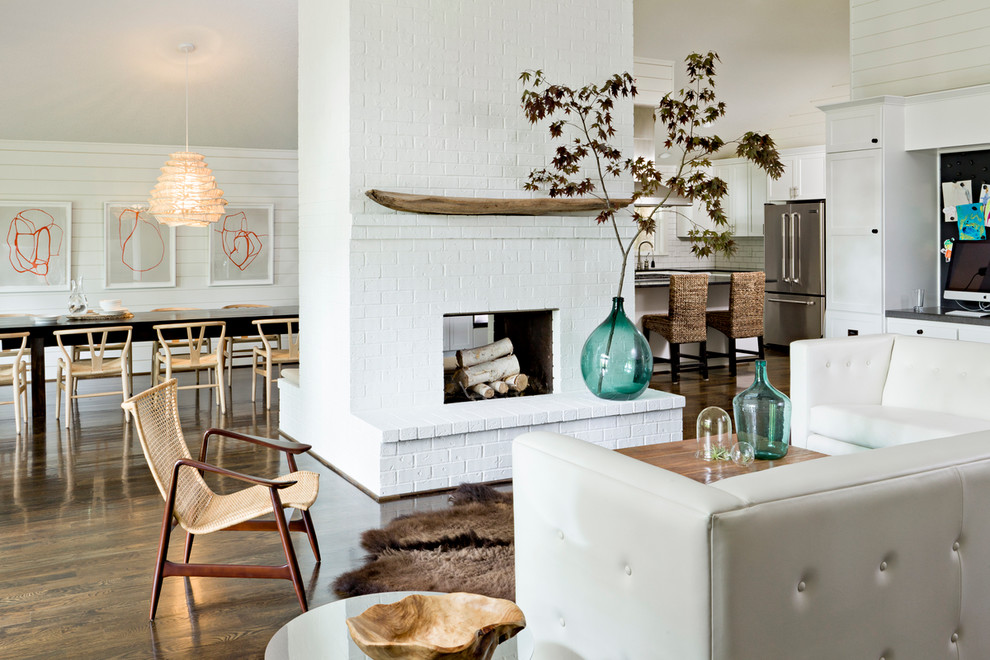 Trendy open concept living room photo in Portland with white walls, a two-sided fireplace and a brick fireplace