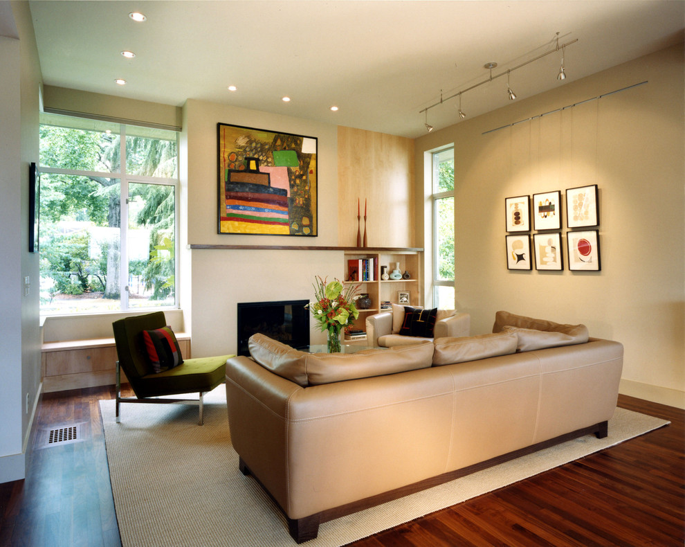 Trendy living room photo in Seattle with beige walls and a standard fireplace