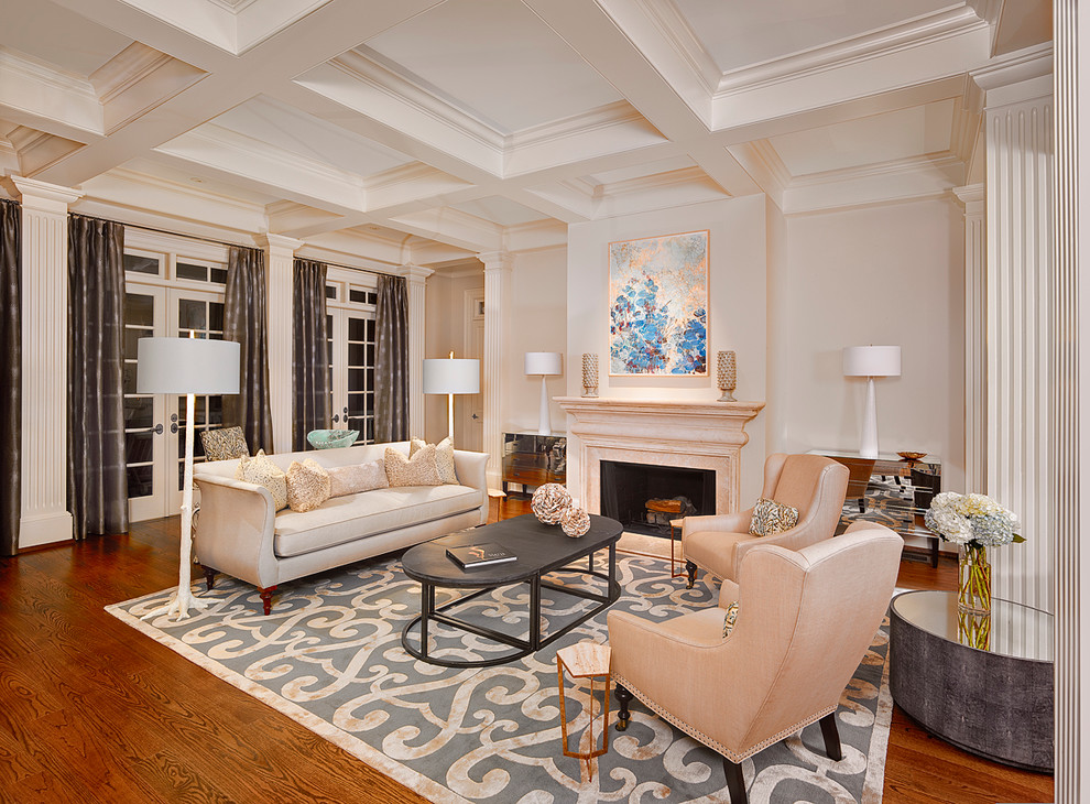 Example of a classic formal medium tone wood floor living room design in Charleston with beige walls, a standard fireplace and no tv