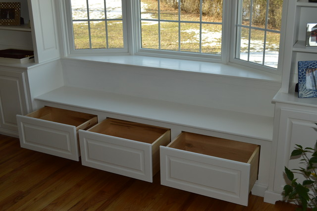 Built in book shelf 39 s and bay window with seat and draws for Bay window seat cost uk
