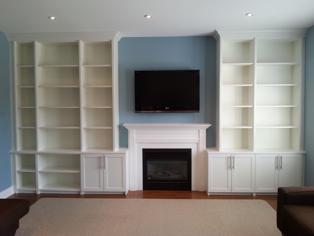 a wall of kitchen cabinets built in living room cabinets traditional living room 10403