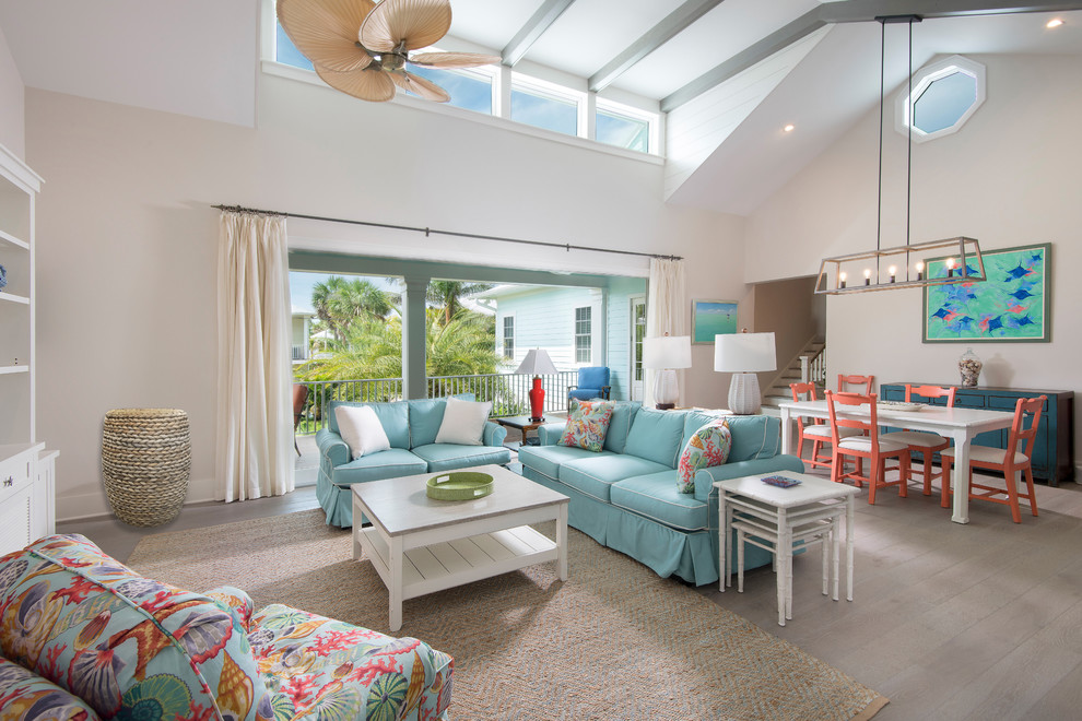 Example of a mid-sized beach style open concept light wood floor and beige floor living room design in Tampa with white walls and no fireplace