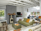 midcentury living room Houzz Tour: In Ireland, a Light and Airy Lakeside Cabin (19 photos)