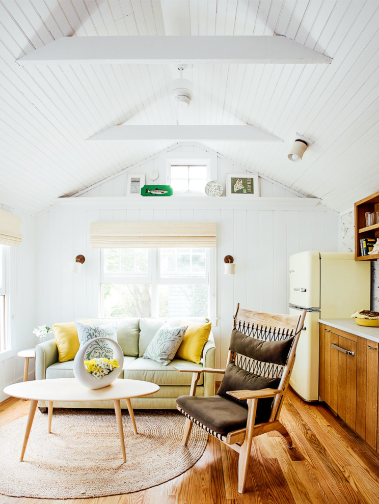 Small beach style open concept medium tone wood floor living room photo in Portland Maine with white walls