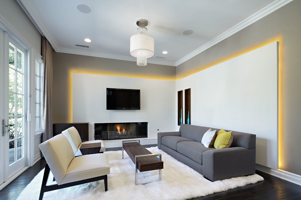 Living room - large contemporary formal and open concept dark wood floor living room idea in Los Angeles with gray walls, a ribbon fireplace and a wall-mounted tv