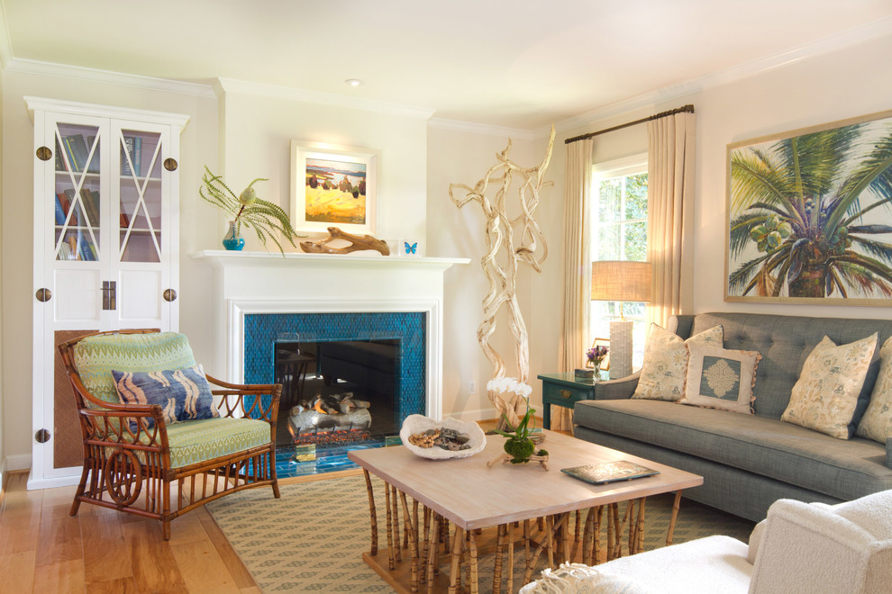 Living room - coastal enclosed living room idea in Los Angeles with beige walls, a standard fireplace and a tile fireplace