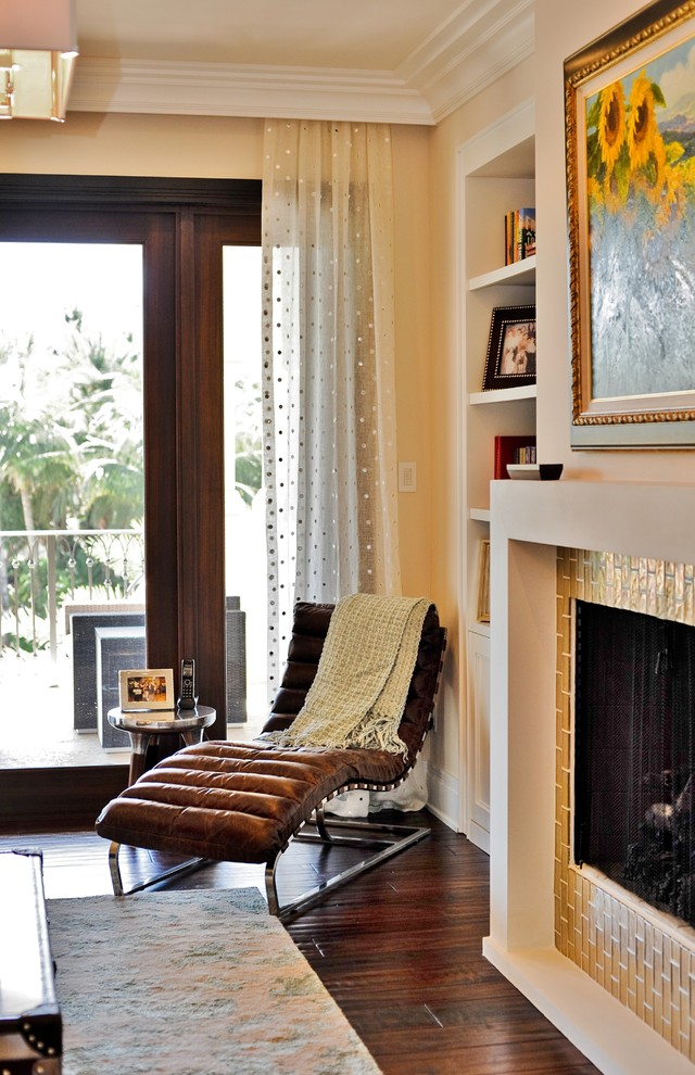 Trendy living room photo in Miami with a standard fireplace and a tile fireplace