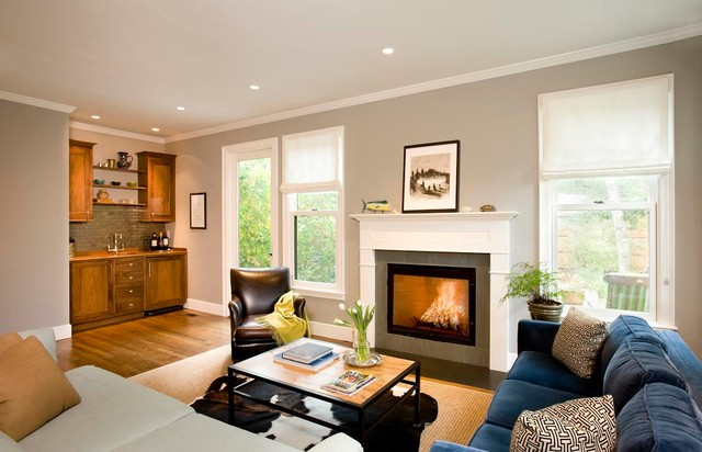 Inspiration for a mid-sized transitional formal and enclosed medium tone wood floor living room remodel in Boston with gray walls, a standard fireplace and no tv