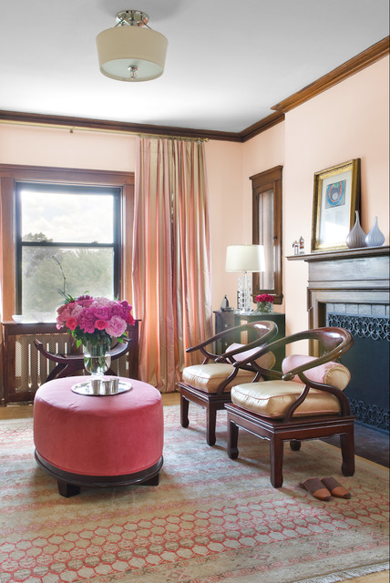 Living room - traditional living room idea in Boston with pink walls and a standard fireplace