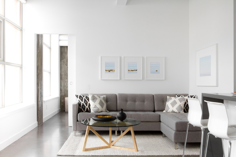 Mid-sized minimalist formal and open concept concrete floor and gray floor living room photo in Toronto with white walls, no fireplace and no tv