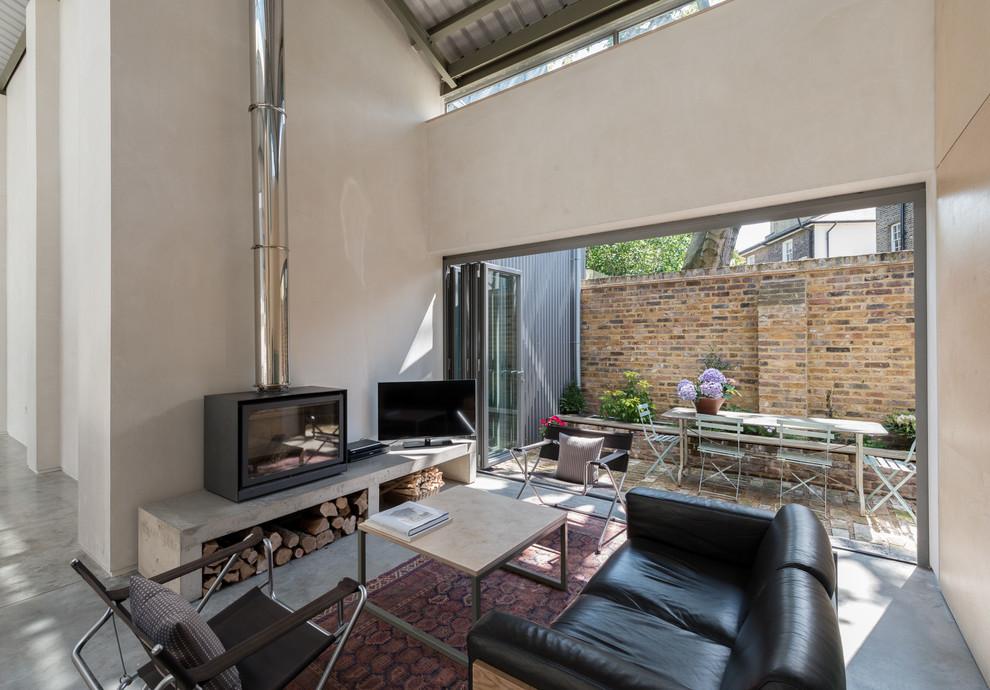 Living room - industrial living room idea in London