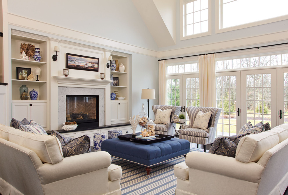 Inspiration for a large coastal enclosed dark wood floor living room remodel in Portland with blue walls, a standard fireplace and a stone fireplace