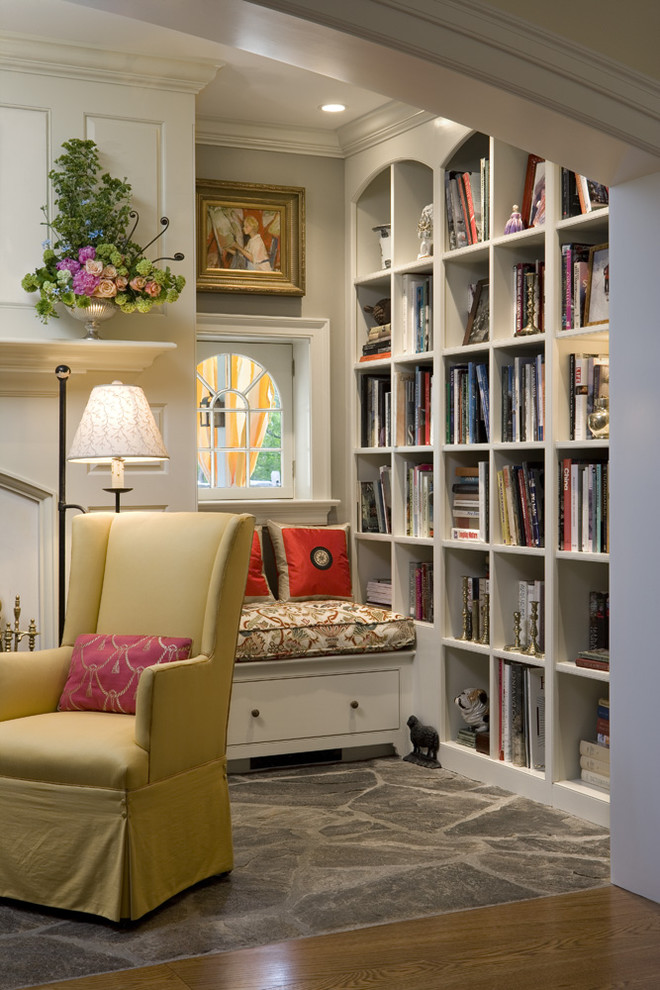 Example of a classic medium tone wood floor living room library design in Philadelphia with gray walls and no tv