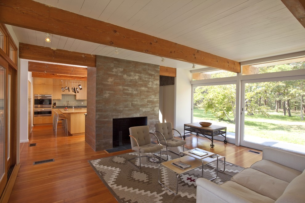 Example of a 1960s living room design in Boston with a stone fireplace