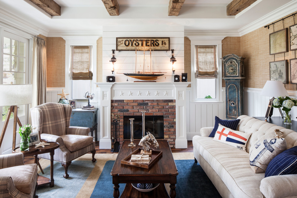 Inspiration for a coastal enclosed living room remodel in Los Angeles with a standard fireplace and a brick fireplace