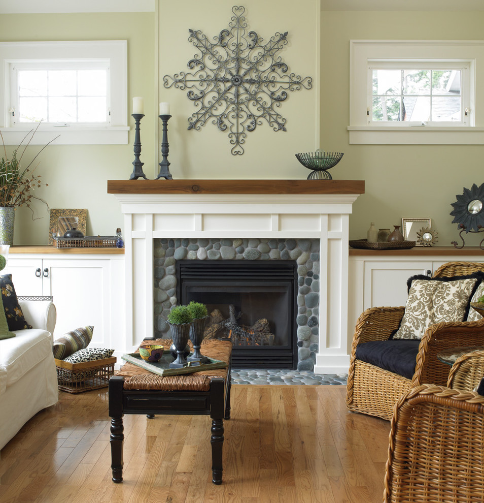 Inspiration for a timeless medium tone wood floor living room remodel in Vancouver with beige walls and a standard fireplace