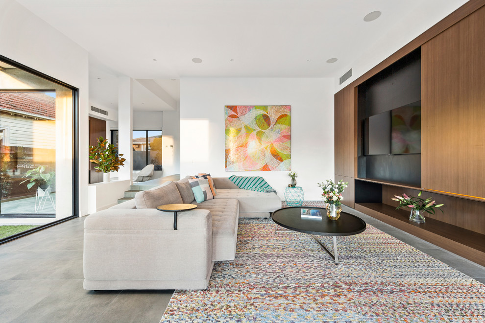 Inspiration for a contemporary open concept living room in Melbourne with white walls and a concealed tv.