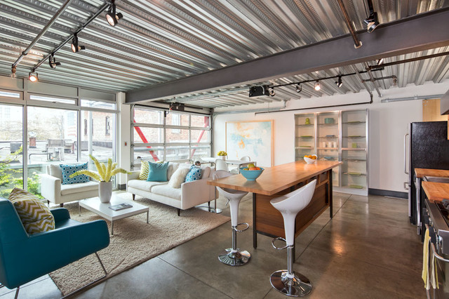 Inspiration For An Concrete Floor Living Room Remodel In Seattle With White Walls No