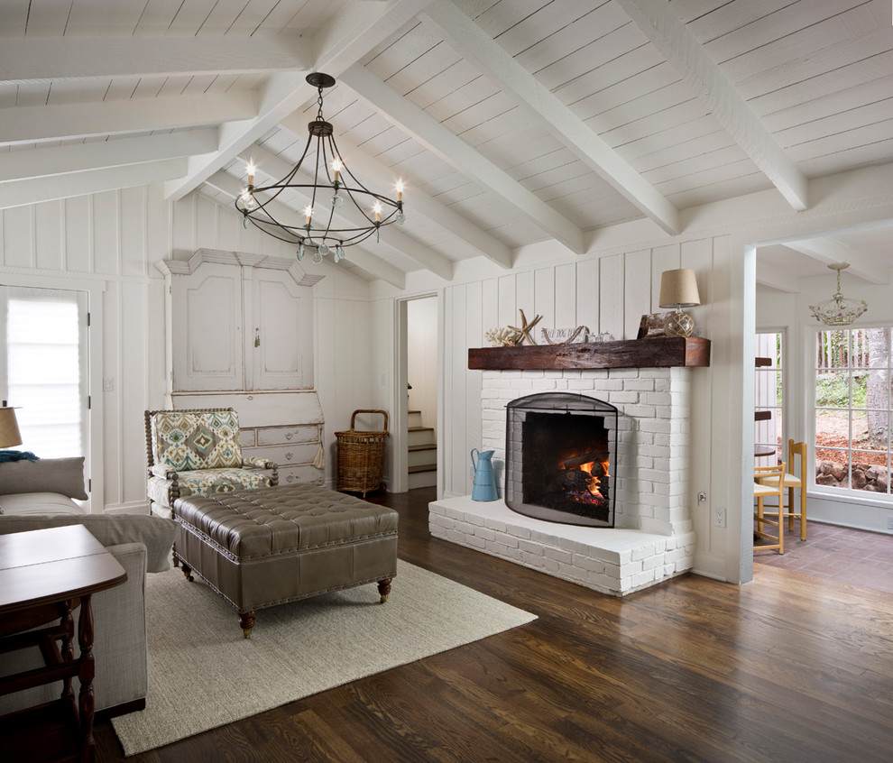 Inspiration for a mid-sized transitional formal and open concept dark wood floor and brown floor living room remodel in Other with white walls, a standard fireplace, a stone fireplace and no tv