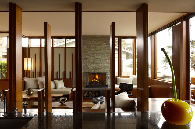 Example Of A Minimalist Living Room Design In Chicago With Standard Fireplace