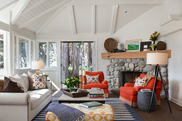 Inspiration for a beach style dark wood floor living room remodel in Denver with white walls, a corner fireplace and a stone fireplace